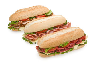 Trio of fresh submarine sandwiches on white background - salami, ham and turkey